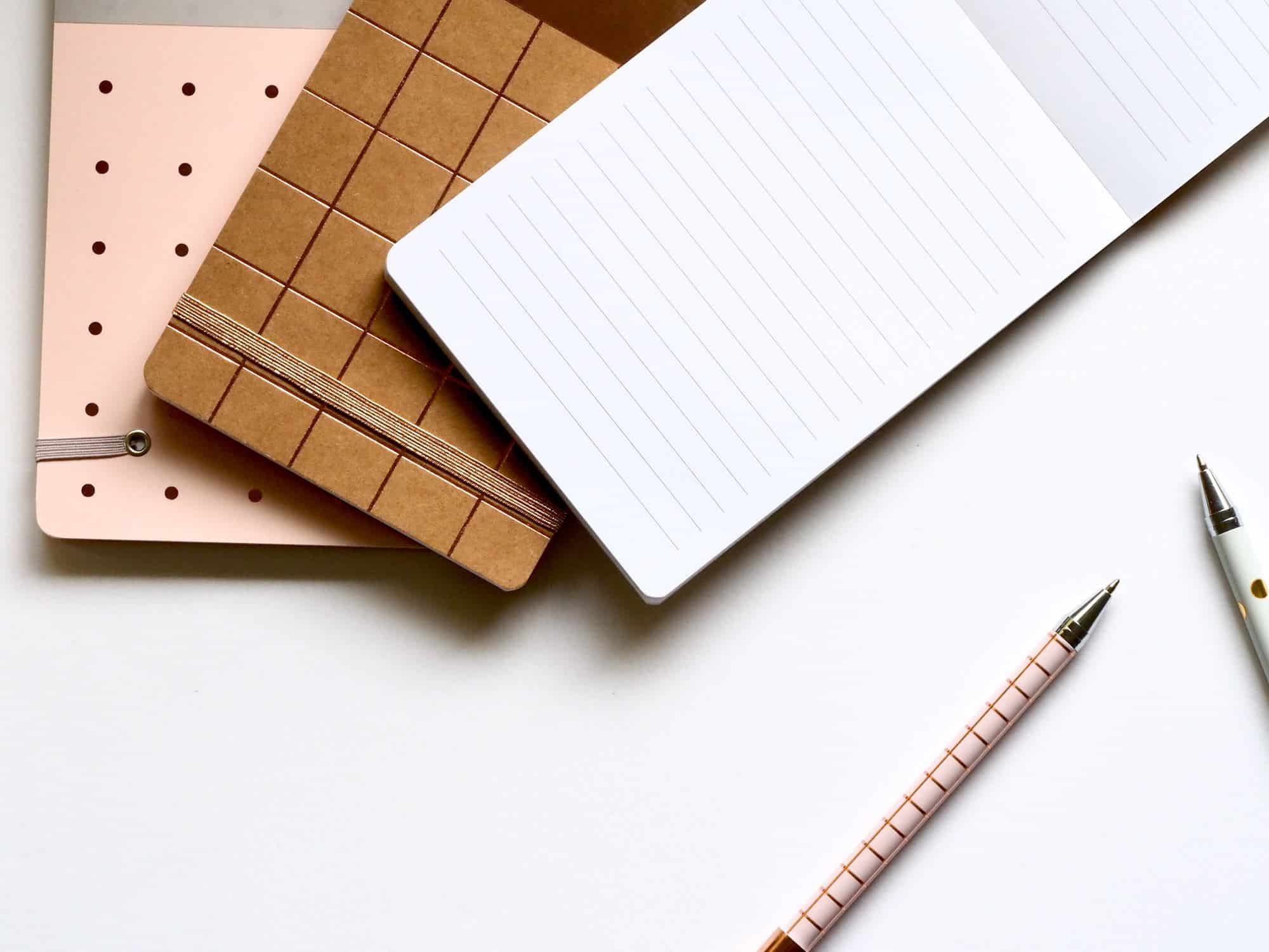 a pencil and three different surfaces to hold information are spread across the image