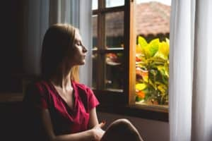 woman looking out an open window