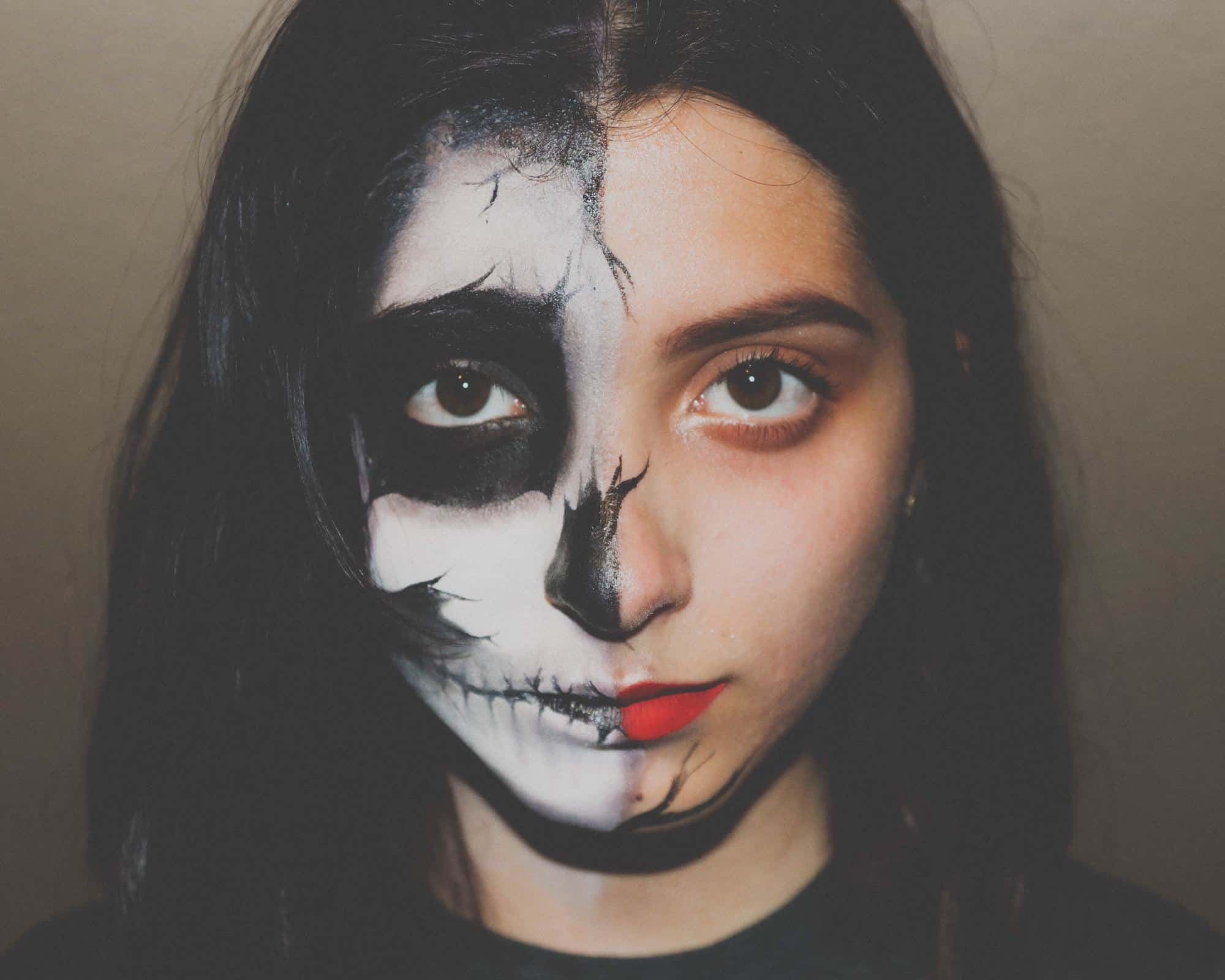 How healthy is your mind? a girl with the left half of her face made up to appear like a skull