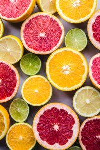 slices of grapefruit, orange, lemon, and lime next to one another