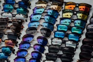 A table displays multiple rows of sunglasses, each of which has a slightly different shape or tint to it.