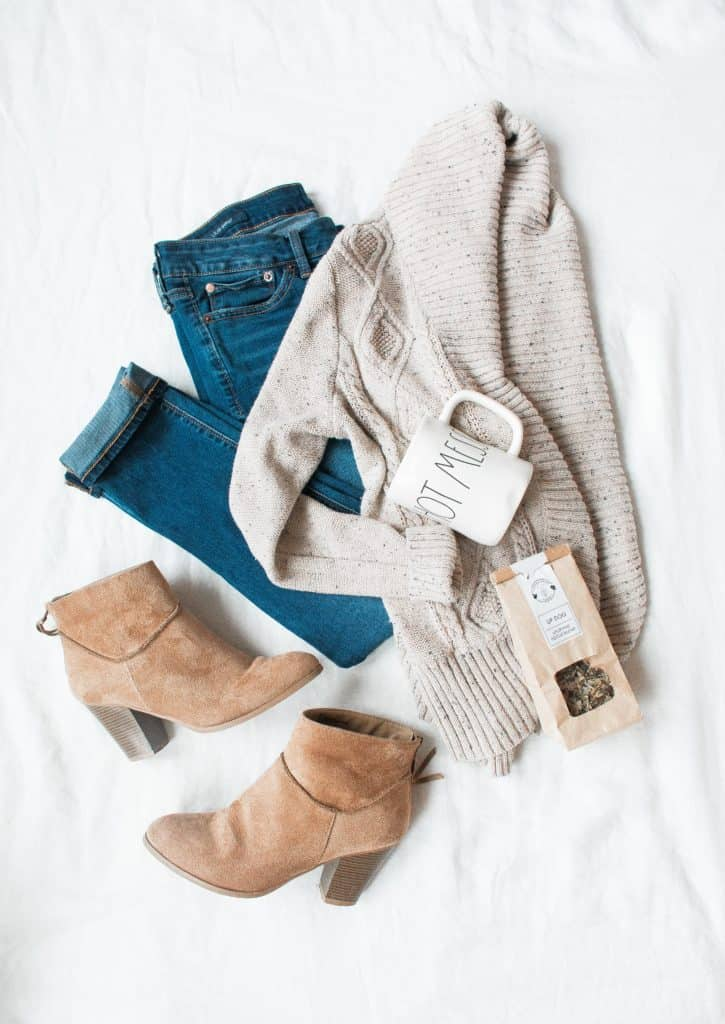 sweater, jeans, and boots laid out to be worn later