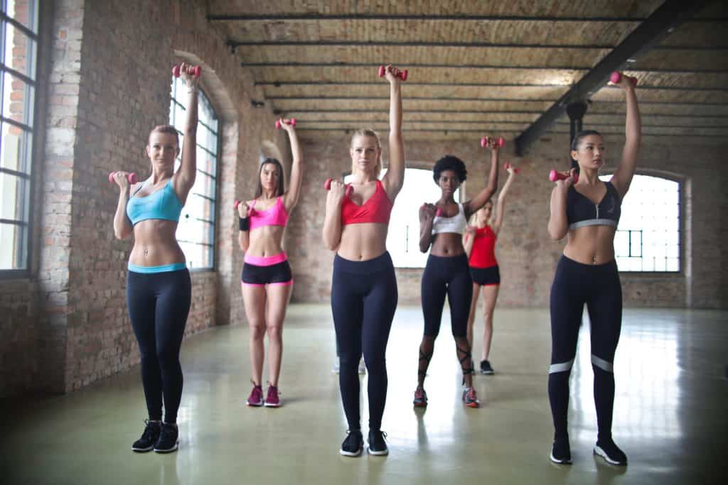 women exercising with small weights