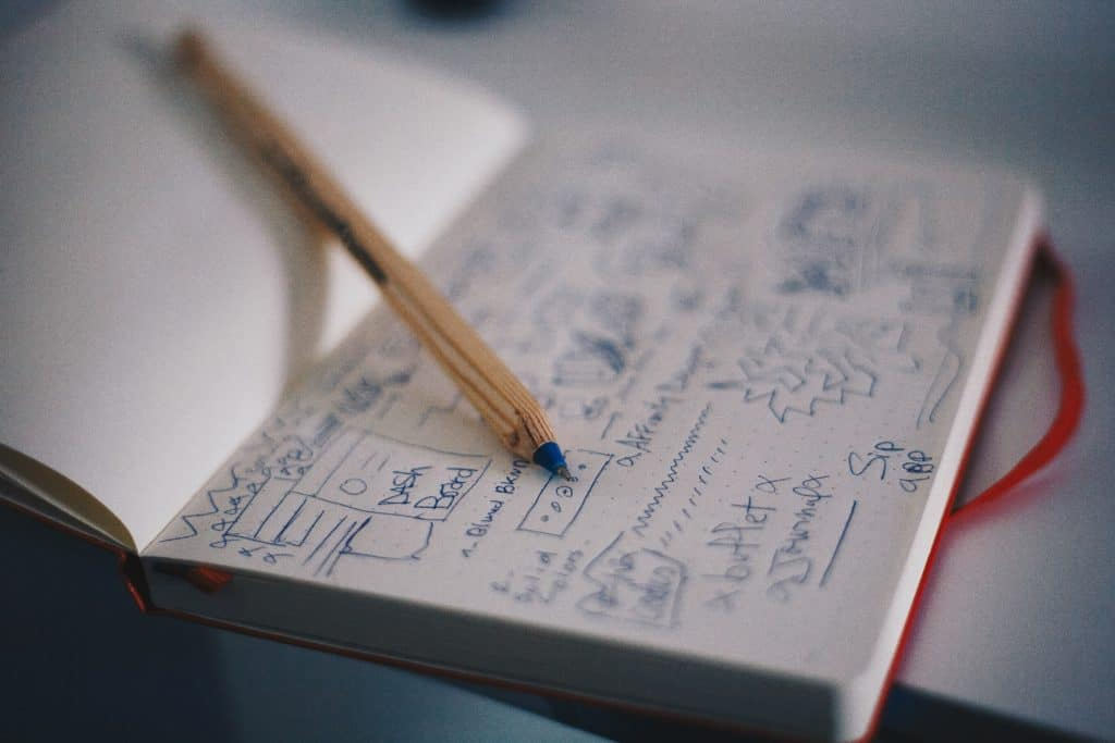 pencil over a notebook full of writing