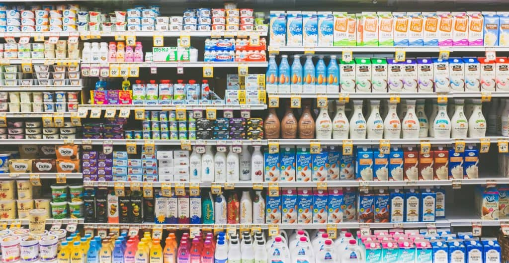 store shelves full of dairy products