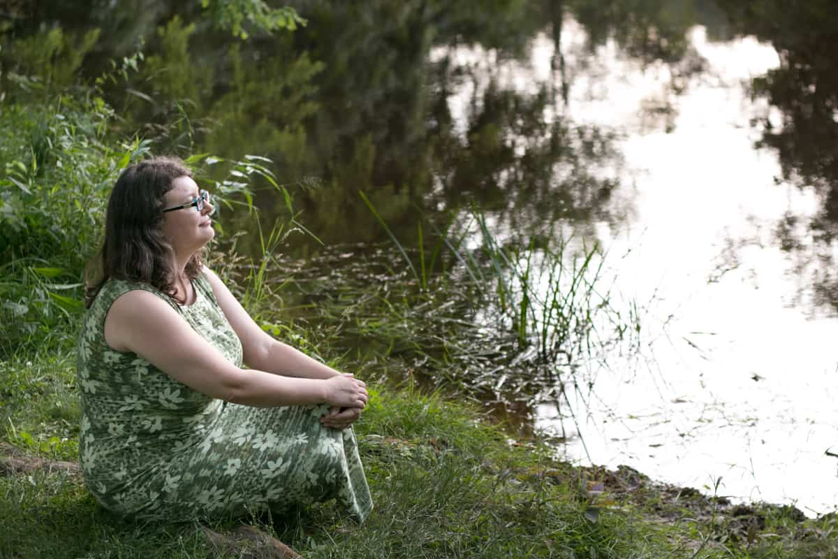 me, sitting and looking at a pond