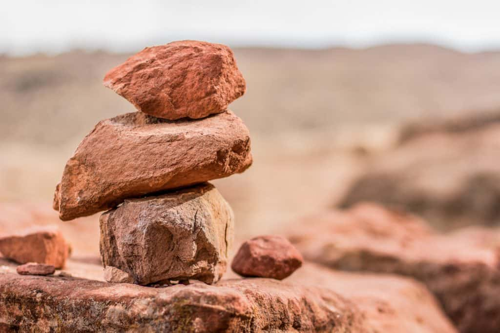 three rocks stacked on top of one another, around the same size