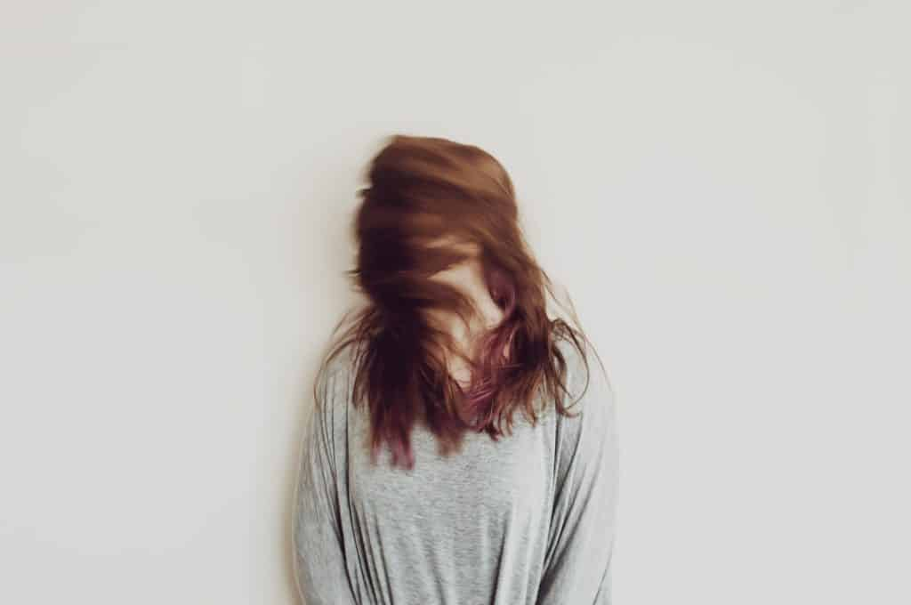 woman shaking her head in blurred image