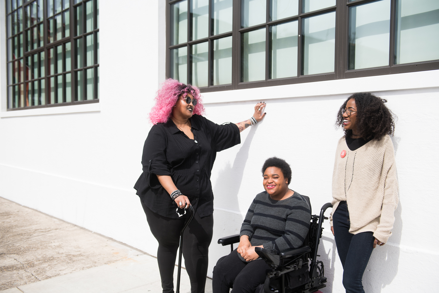 3 black disabled folx gather to chat and laugh