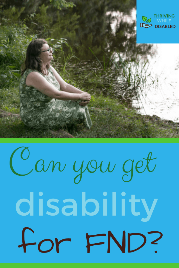 Pinterest image: In the upper right corner of the picture is the Thriving While Disabled logo, while the upper half is a picture of Alison sitting on the ground in a green dress while contemplating a lake to her left. The lower half of the image reads 'Can you get disability for FND?'