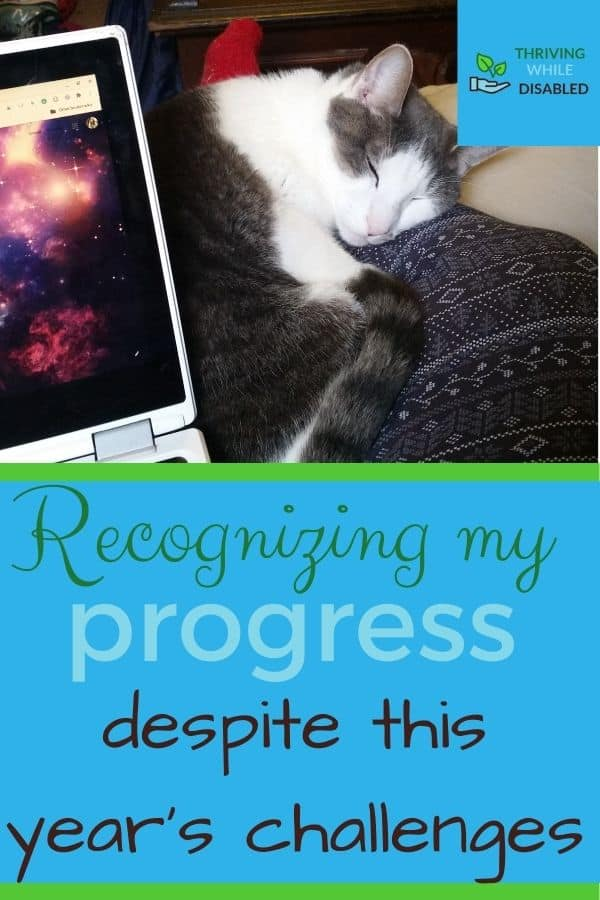 Pinterest image: In the upper right corner of the picture is the Thriving While Disabled logo, while the upper half is a picture of A white and gray cat-Rorschach- lies curled up on Alison's lap. Her chromebook is just visible to the left. The lower half of the image reads 'Recognizing my process despite the year's challenges'