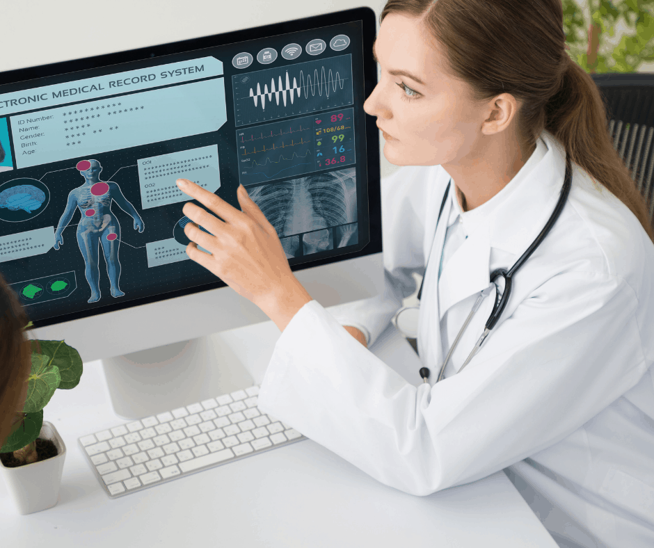 doctor points out information on computer-based medical records