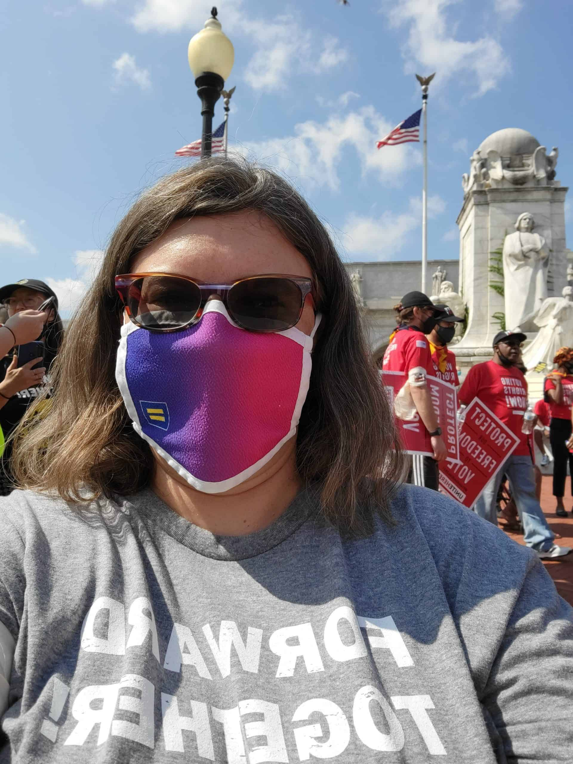 Alison in Bi mask at Poor People's Campaign rally 8/2